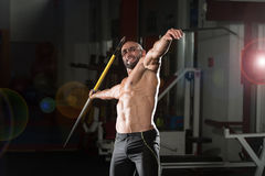 Mature Male Athlete Practicing To Throw A Javelin Royalty Free Stock Photo