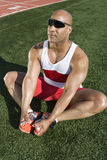 Mature Male Athlete Stretching Stock Photo