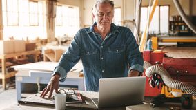 Mature male carpenter in his workshop stock image