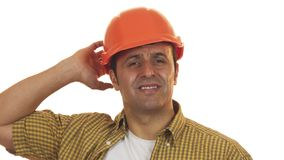 Mature male constructionist in hardhat looking upset and disappointed. Close up of a guilty male professional construction worker looking upset and worried royalty free stock photography