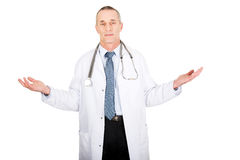 Mature male doctor holding copyspace Royalty Free Stock Photo