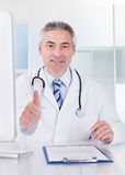 Mature Male Doctor Showing Thumbs Up Sign Stock Photo