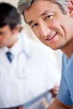 Mature Male Doctor Smiling Stock Image