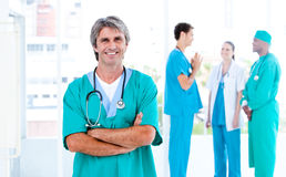MAture male doctor standing with his team Royalty Free Stock Images