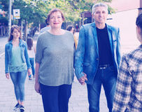 Mature male and female walking on vacation stock image