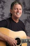 Mature Male Guitarist Stock Photo