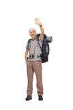Mature male hiker waving at the camera Royalty Free Stock Photos