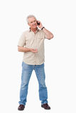 Mature male on his cellphone Royalty Free Stock Photo