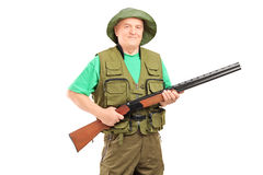 A mature male hunter holding a rifle Royalty Free Stock Photo
