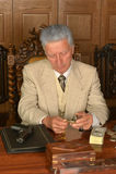 Mature male mafia boss. On the table with gun Stock Photo