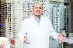 Mature male ophthalmologist working Stock Images