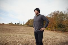 Mature Male Runner Pausing For Breath During Exercise In Woods Royalty Free Stock Images