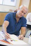 Mature male student in art class.  Stock Image