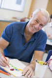 Mature male student in art class.  Stock Photos