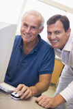 Mature male student learning computer skills Stock Photos