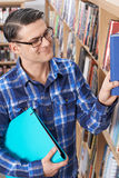 Mature Male Student Studying In Library. Mature Male Student In Library Royalty Free Stock Images
