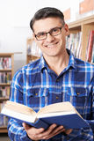 Mature Male Student Studying In Library. Portrait OF Mature Male Student Studying In Library Stock Photos