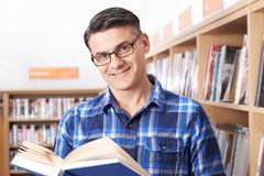 Mature Male Student Studying In Library. Mature Male Student Studies In Library Royalty Free Stock Image