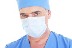 Mature male surgeon with medical mask. Portrait of mature male surgeon in medical mask - isolated on white Royalty Free Stock Photography