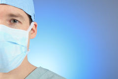 Mature male surgeon over a blue background Royalty Free Stock Photography