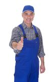 Mature male technician making thumbs up gesture. Over White Background Royalty Free Stock Images