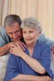 Mature man. Hugging his wife royalty free stock image
