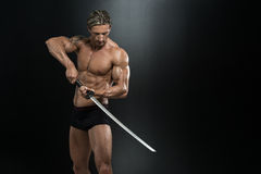 Mature Man In Action With Sword Stock Images