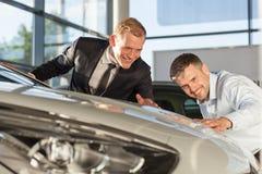Mature man admiring expensive vehicle Stock Photo
