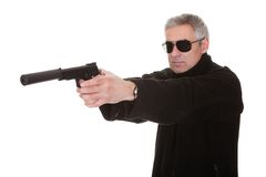 Mature Man Aiming With Handgun Royalty Free Stock Image