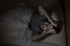 Mature man angry from not being able to sleep. Top view image of mature man showing anger from insomnia Stock Photography