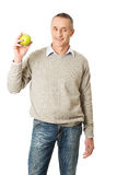 Mature man with an apple Royalty Free Stock Photos