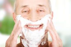 Mature man applying shaving foam Royalty Free Stock Images