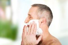 Mature man applying shaving foam Stock Photo