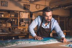 Mature man in an apron Royalty Free Stock Images