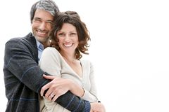 Mature man with arms around his beautiful wife Royalty Free Stock Images