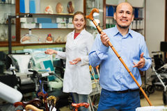 Mature man asking positive  female doctor about walking sticks Stock Images