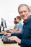 Mature Man Attending Computer Class. Mature Man Attends Computer Class Stock Photos