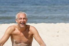 Mature man on a beach royalty free stock photo