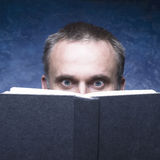 Mature man being focused and hooked by book. Stock Photography