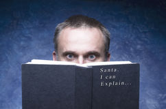 Mature man being focused and hooked by book. Santa I can explain... royalty free stock image