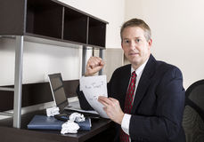 Mature Man being Positive while working on Income Taxes Royalty Free Stock Photography