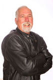 Mature man in a biker jacket Royalty Free Stock Image