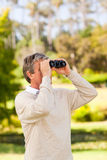 Mature man birds watching Stock Image