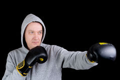 Mature man with boxing gloves Stock Photos