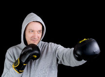 Mature man with boxing gloves Stock Images