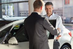 Mature man buying new car Stock Photo