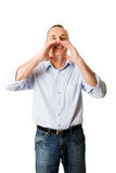Mature man calling someone Royalty Free Stock Image