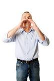 Mature man calling someone Royalty Free Stock Image