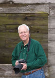 Mature man with camera Royalty Free Stock Image
