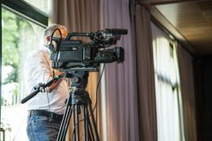 Mature man camera operator stock photo